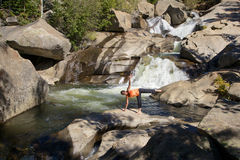 Woman Practicing Yoga at Waterfall Stock Photos