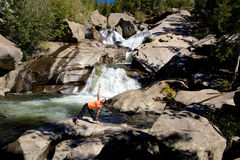 Woman Practicing Yoga at Waterfall Royalty Free Stock Photos