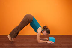 Woman Practicing Yogasana Royalty Free Stock Image