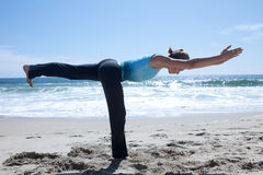 Woman Practicing Yogo at the Beach Royalty Free Stock Image