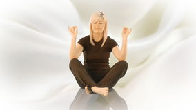 Woman practicising Yoga on her own Stock Images