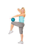 Woman practises with blue ball Stock Photography