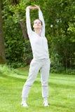 Woman during practising in garden Stock Image