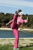 Woman practising king fu kick Stock Images