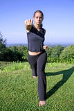 Woman practising self defense Stock Photo