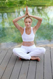 Woman practising yoga Royalty Free Stock Photo