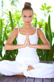 Woman practising yoga Royalty Free Stock Images