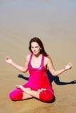 Woman practising yoga on beach Royalty Free Stock Photography