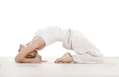 Woman practising yoga exercise Stock Photo