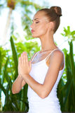 Woman practising yoga and meditating Royalty Free Stock Images