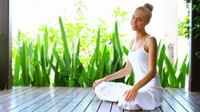 Woman practising yoga and meditating Stock Photos