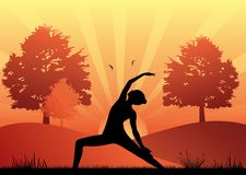 Woman practising yoga at moonlight background Stock Photos