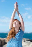 Woman practising yoga at the sea Stock Images