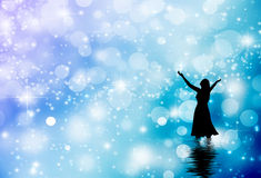 Woman praising. A woman lifting her hands in worship int he water Stock Photos