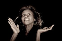 Woman praising God. African american woman lifting her hands and praising God Royalty Free Stock Photos
