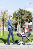 Woman with a pram Stock Images
