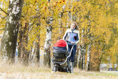 Woman with a pram Stock Photo