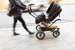 Woman with pram Royalty Free Stock Photo
