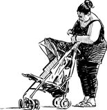 Woman with a pram Stock Photography
