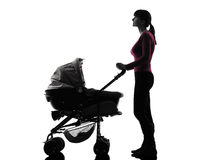 Woman prams baby looking up silhouette Stock Photography