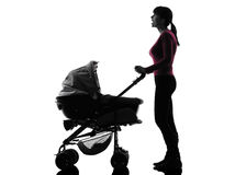 Woman prams baby looking up surprised  silhouette Stock Photo