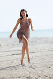 Woman prancing on the sand Stock Photo