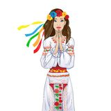 Woman pray clasp hands ukrainian national clothes Stock Image