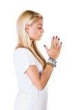 Woman pray his god. White background Stock Photos