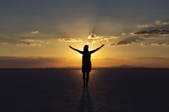 Woman pray for joy and happiness at sunset.  royalty free stock photo