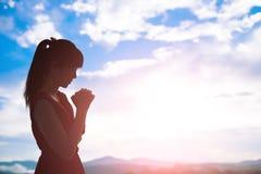 Woman pray pious Royalty Free Stock Image