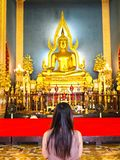 Woman pray The Shinarath buddha in Bangkok Stock Images
