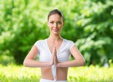 Woman prayer gesturing Stock Photo
