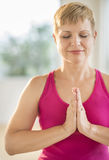 Woman In Prayer Position Practicing Yoga Stock Photography