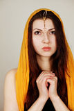Woman praying. Devout sincere young woman praying royalty free stock images