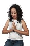 Woman praying Royalty Free Stock Image