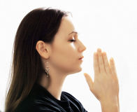 Woman Praying. A woman praying with her hands together on white background Royalty Free Stock Images