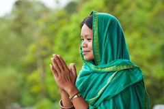 Woman praying. Young south-east asian woman praying with head dress Royalty Free Stock Photography