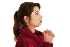 Woman praying. Closeup portrait of a young caucasian woman praying , isolated on white background Stock Photo