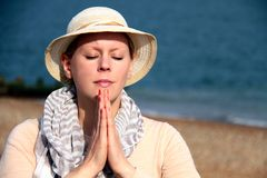 Woman praying. Image of a woman praying on a sunday Royalty Free Stock Images