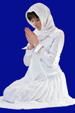 A woman praying Royalty Free Stock Photography