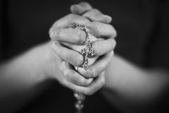 Woman Praying. Woman folding hands and pray to God royalty free stock images