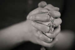 Woman Praying. Woman folding hands and pray to God stock photography