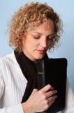 Woman Praying. Young woman praying holding a Bible Royalty Free Stock Image