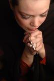 Woman praying Royalty Free Stock Images
