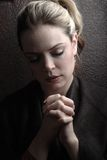 Woman praying Royalty Free Stock Image