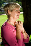 Woman praying Stock Photos