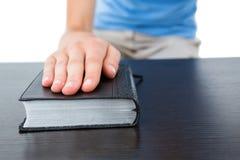Woman praying with bible Stock Photos