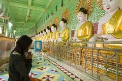 Woman praying Buddha Stock Photos