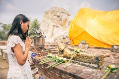 Woman praying at Buddha statue Royalty Free Stock Images