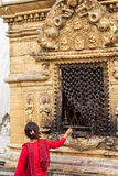 A Woman Praying at a Buddhist Shrine Royalty Free Stock Photography